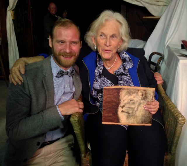 Artist MIchael Heufelder sells his work to Peggy Arundel